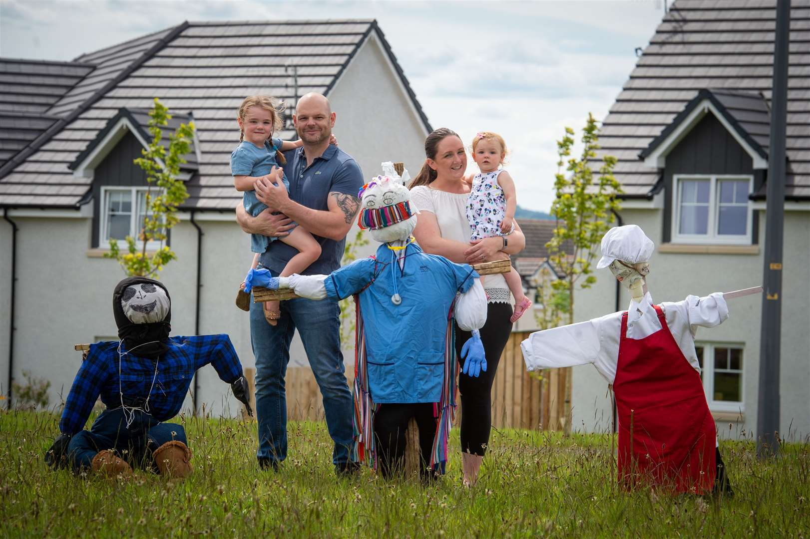 The Mackay family with their nurse-inspired superhero scarecrow. Nurse Barry Mackay with wife Jane and daughters Amber (4) and Autumn (18 months).
