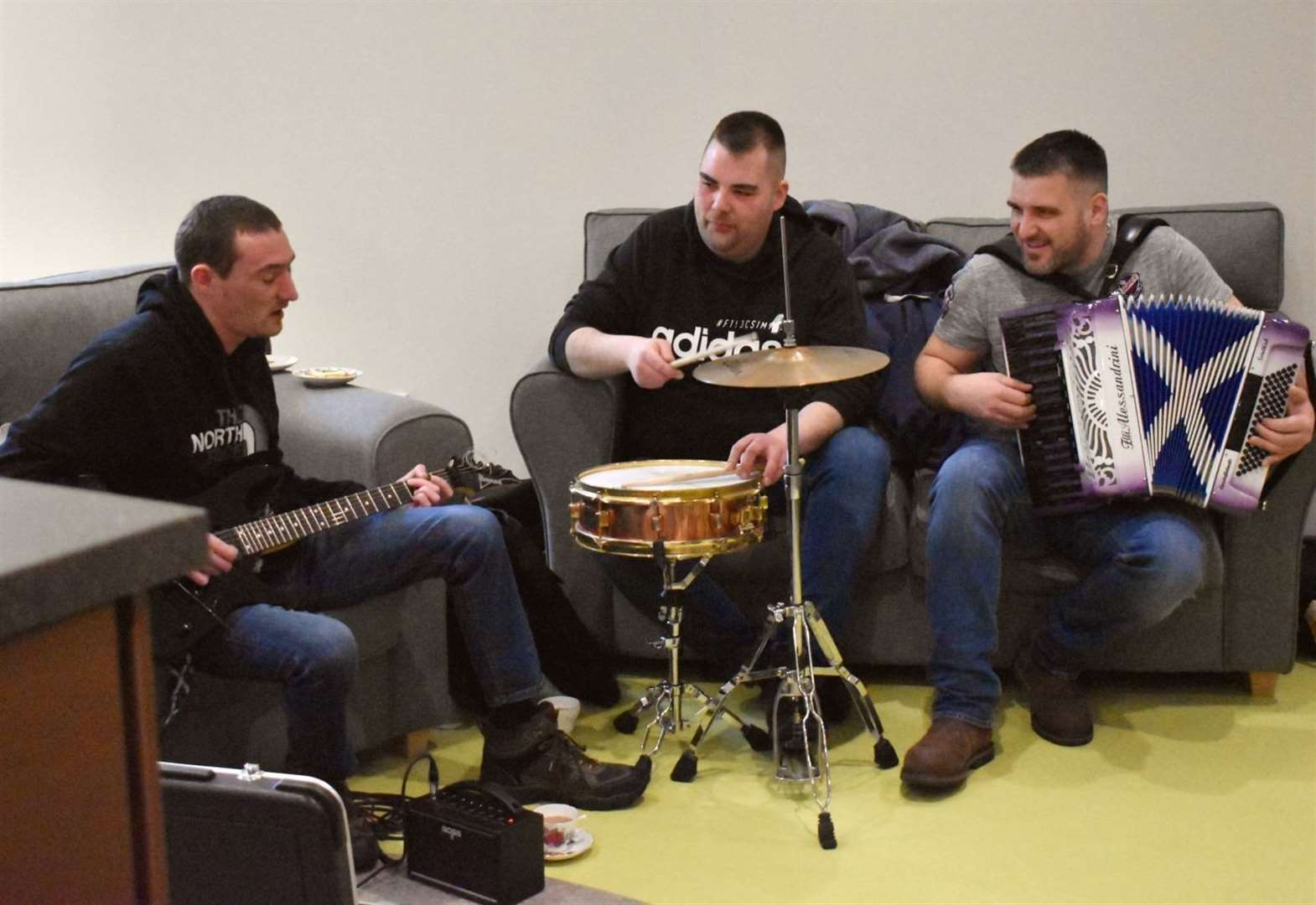 Peat & Diesel perform for patients at Highland Hospice