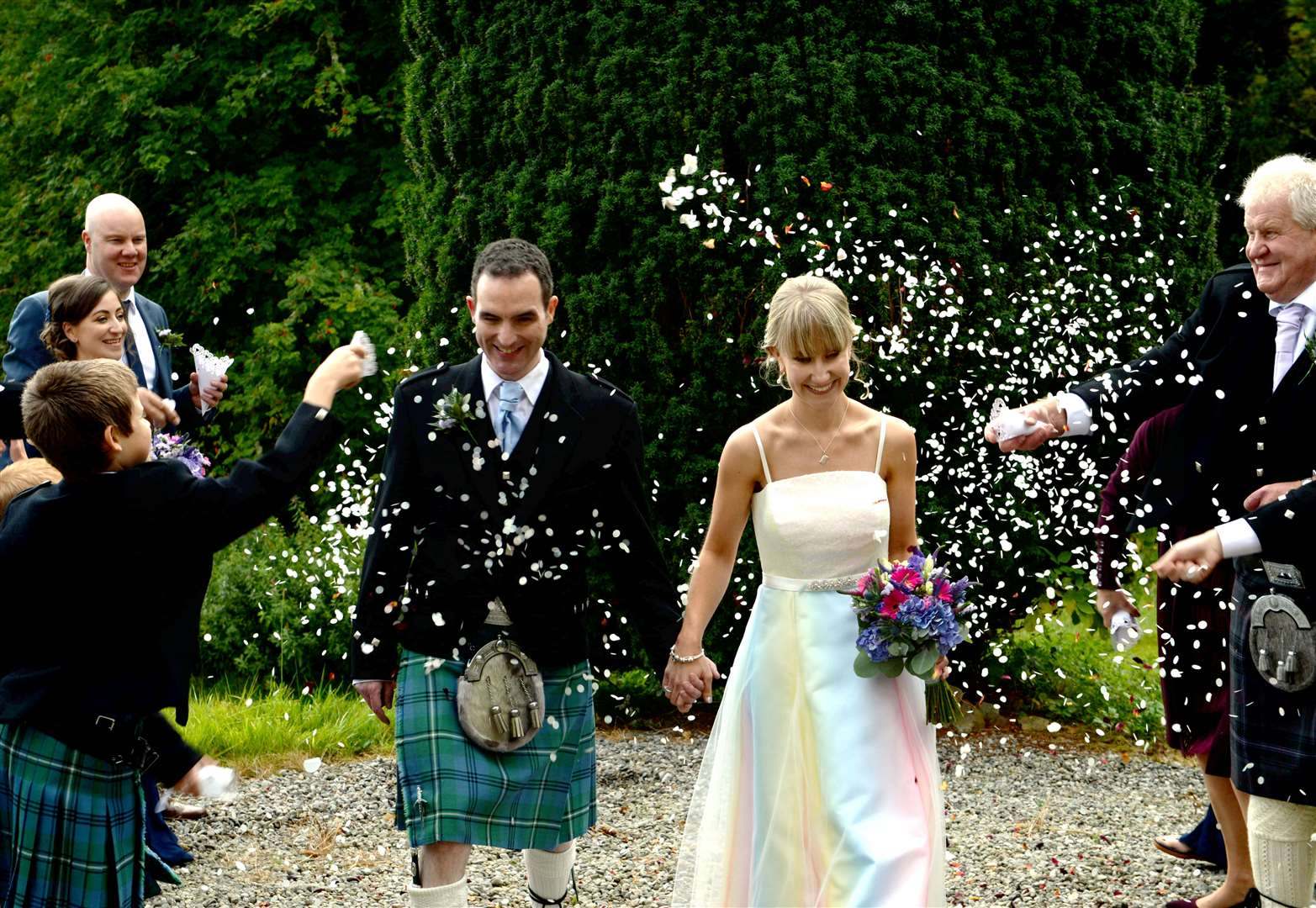Ashley Traill wore a specially designed rainbow dress for her big day.