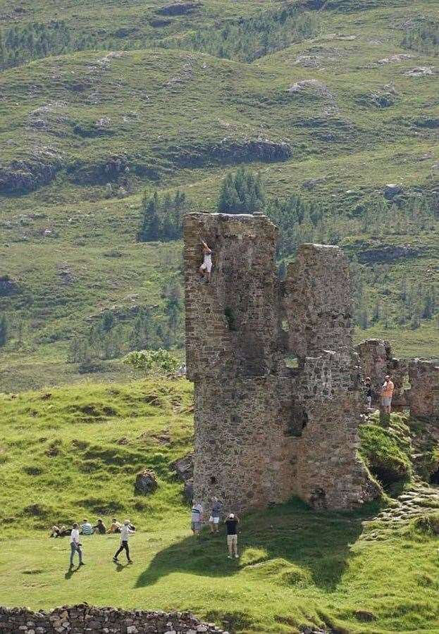 People climbing on the walls of Ardvreck Castle. One visitor also stumbled across an unwelcome 'deposit' just before his kids stepped in it.