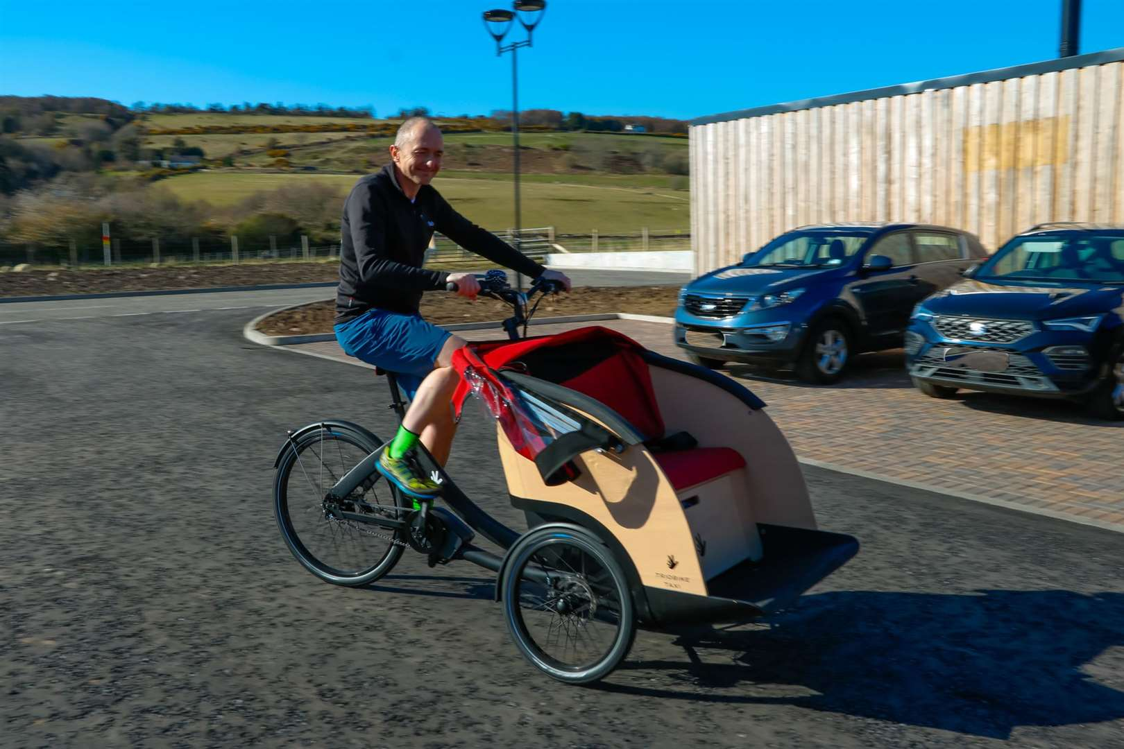 Alan McCaffrey, Fortrose & Rosemarkie chapter captain with Cycling Without Age Scotland, gives a trishaw demonstration