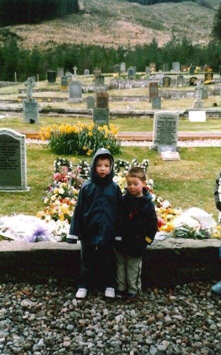 Andrew Wilson and his brother the graveside.