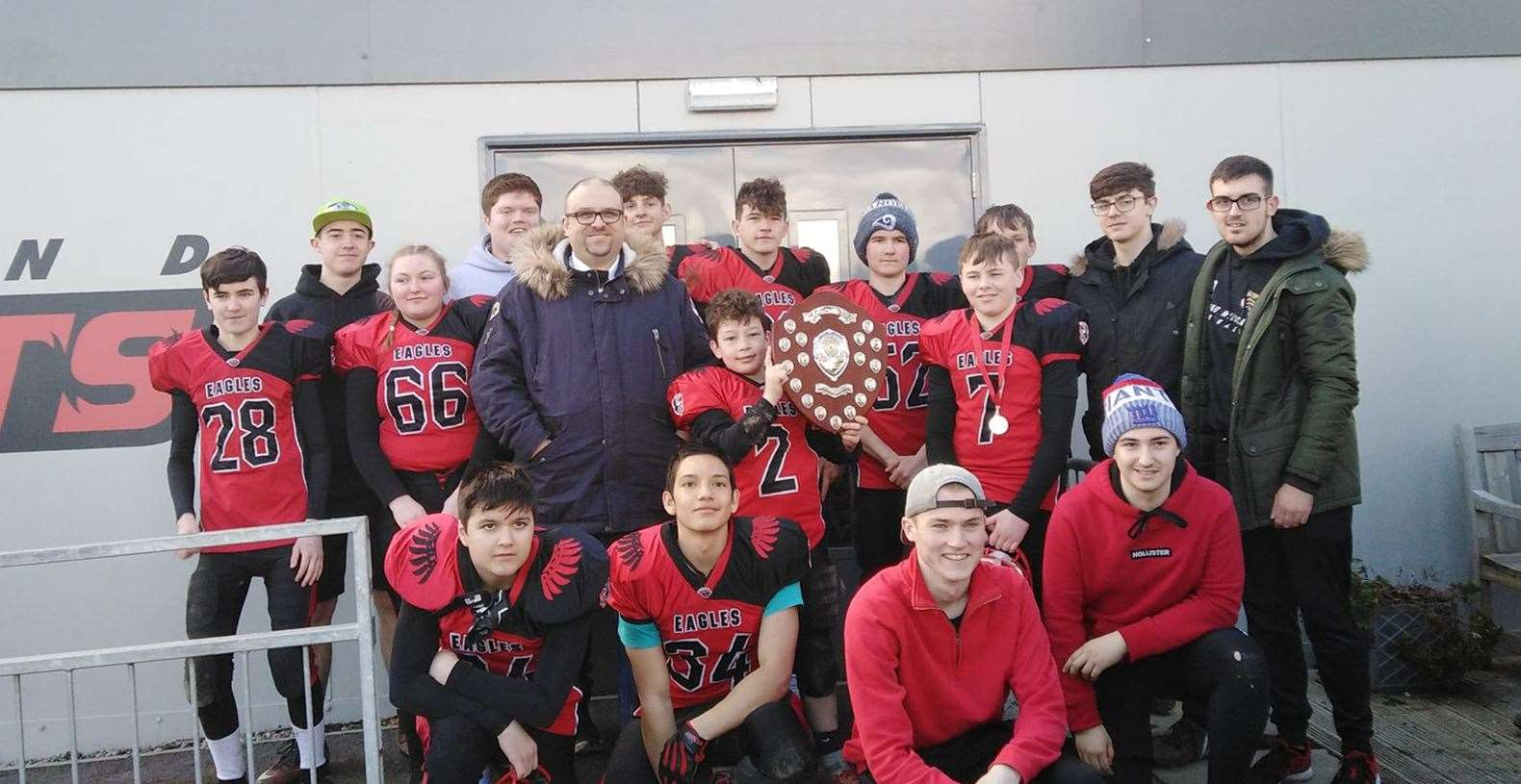 Tim Glews from Reach Digital Telecoms Scotland presents the Millburn Academy Eagles with the Highland Bowl after they beat the Charleston Academy Knights. Picture: Jill Falconer