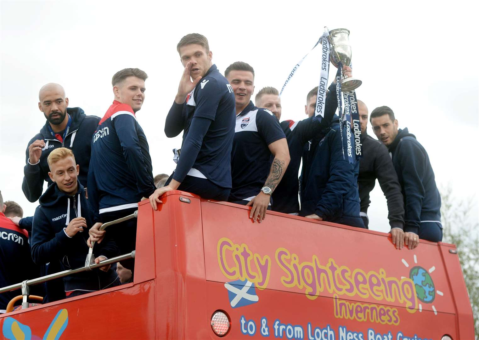 Ross County players on the open top bus parade on Saturday.