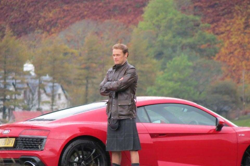 Something for everyone - a nice car, and Mr Heughan.
