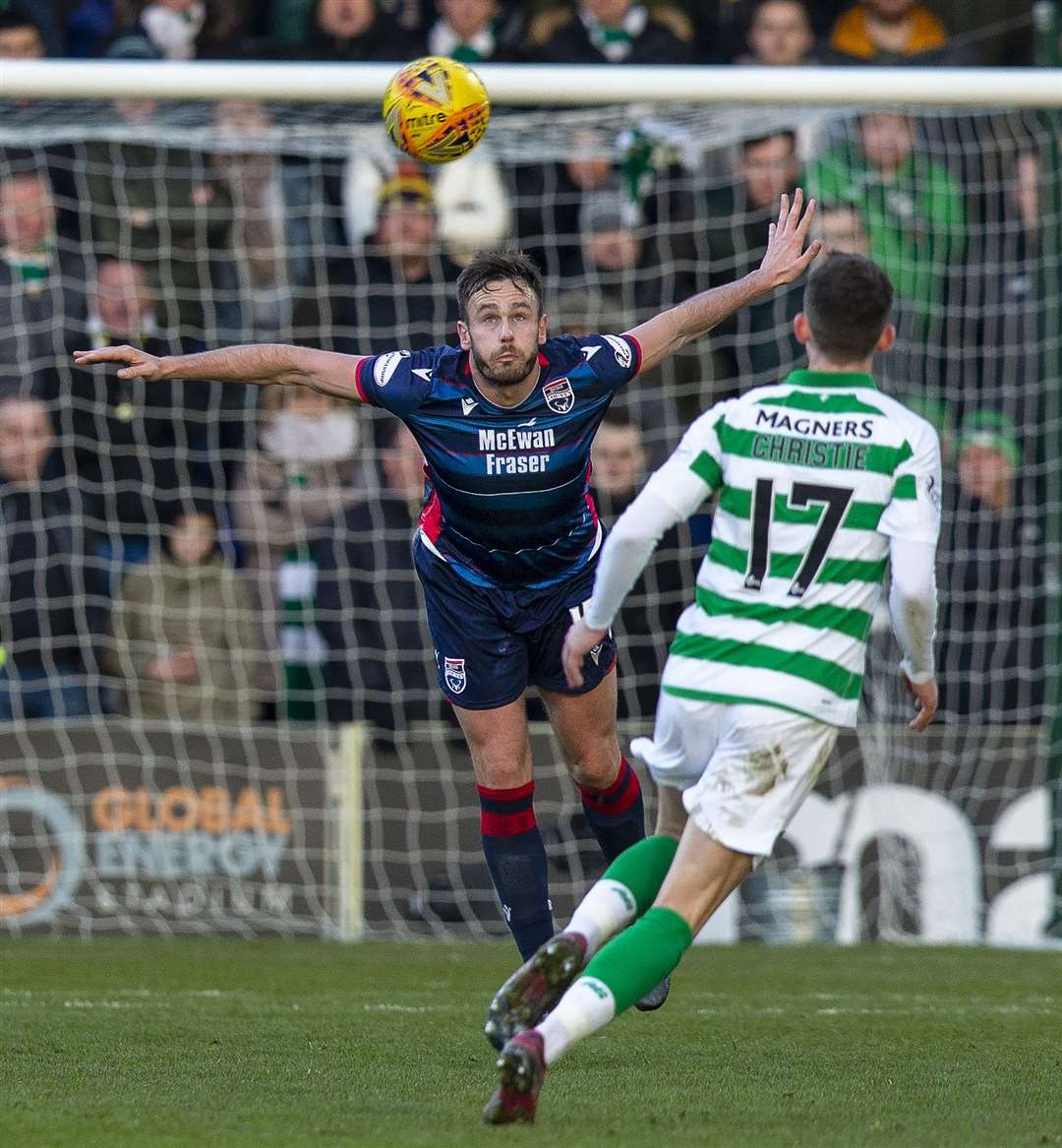 Picture - Ken Macpherson, Inverness. Ross County(1) v Celtic(4). 01.12.19. Ross County's Keith Watson heads clear from Celtic's Ryan Christie.