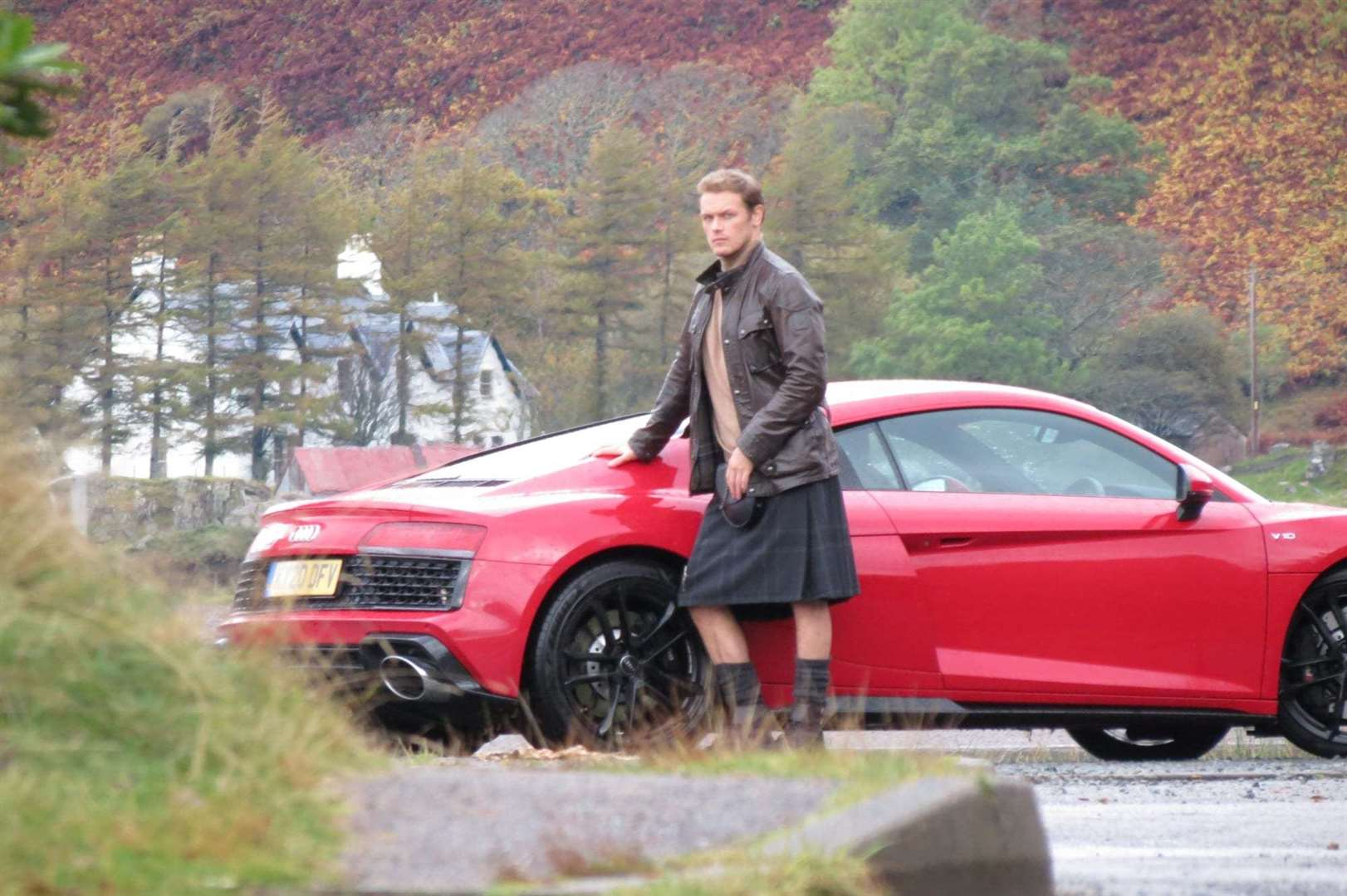 Mr Heughan looked as though he wa enjoying the Highlands.