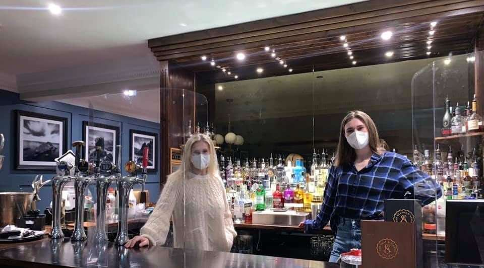 Alison McCosh (left) and Alison Todd take in the view from behind the bar during their stay at the Seafield Arms Hotel in Cullen.