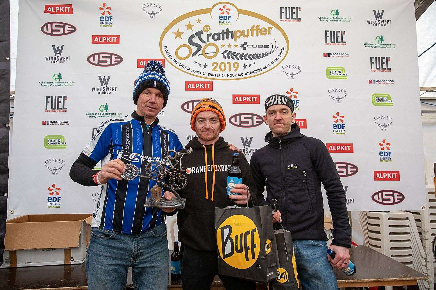 Marty Ross (centre) celebrates winning Strathpuffer 2019. Picture: Gary Williamson Photography