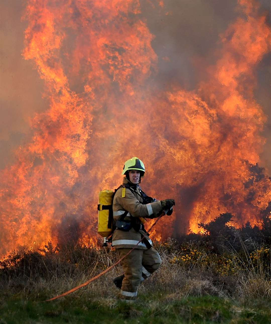 Highland firefighter in action tackling a wildfire. Picture: Gary Anthony.