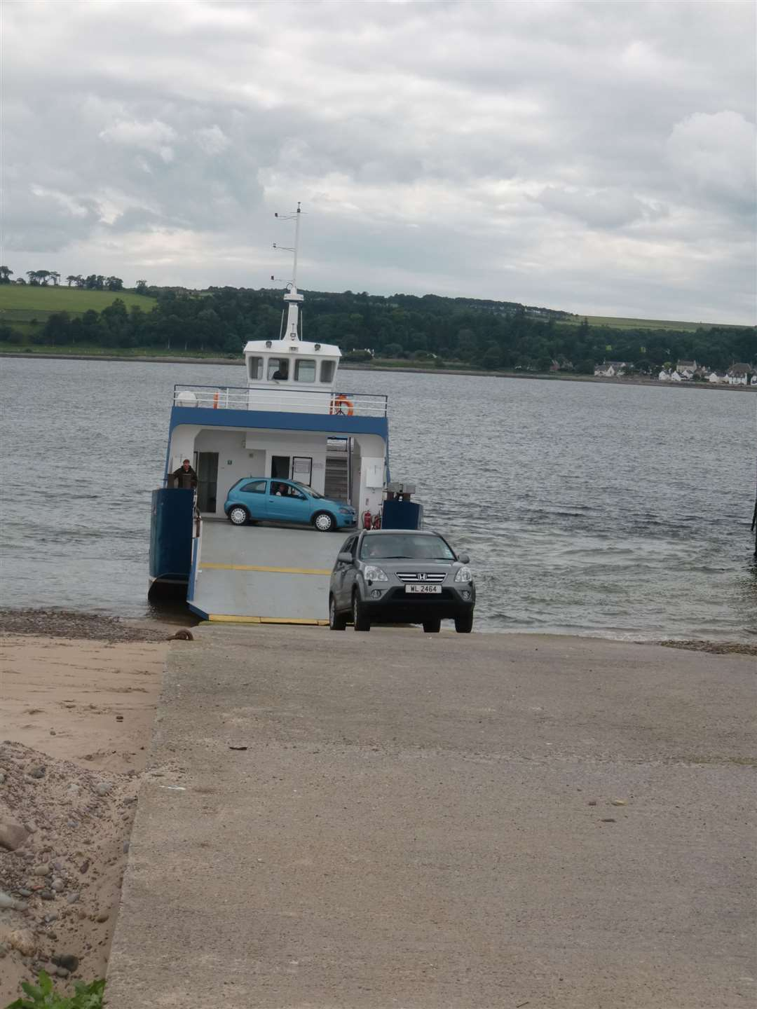 A car disembarks from the ferry at Nigg..