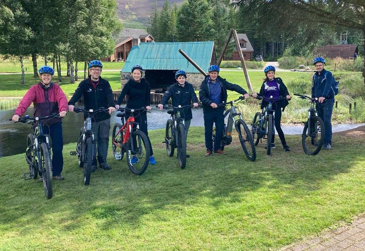 At the Badaguish Outdoor Center are Isabel Hunt of the National Lottery Heritage Fund, Grant Moir of the Cairngorms National Park Authority, Caroline Clark of the National Lottery Heritage Fund, Xander McDade of the Cairngorms National Park Authority, Michael Matheson MSP, Gillian Council of Alzheimer Scotland and Kevin Quinlan of the Scottish Government.